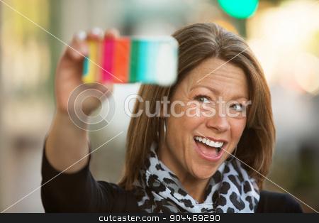 Woman Taking a Self-Portrait stock photo, Beautiful woman in scar taking a self-portrait outdoors by Scott Griessel