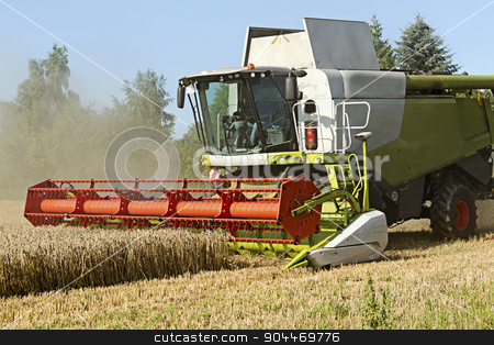 combine harvester working on a wheat field stock photo, combine harvester working on a wheat field, agricultural scene by Maren Winter