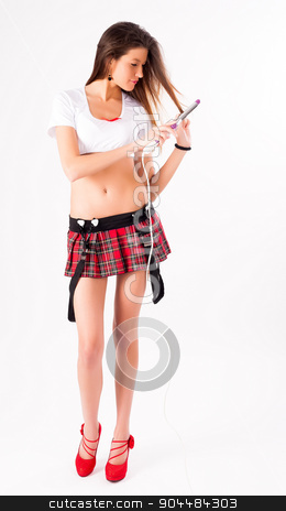 Pretty girl with fluting iron stock photo, Young beautiful woman with fluting iron at white background by Aikon