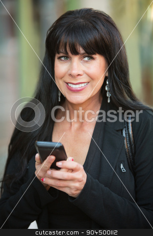 Excited Woman With Phone stock photo, Excited smiling woman using her phone outdoors by Scott Griessel
