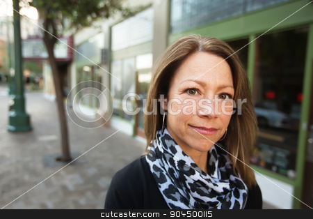 Cheerful Female Entrepreneur stock photo, Beautiful single Caucasian business woman outdoors in front of store by Scott Griessel