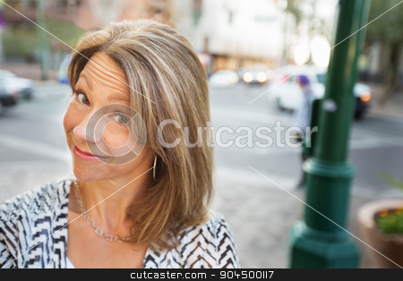 Grinning Woman stock photo, Cute grinning mature woman smiling in urban scene by Scott Griessel