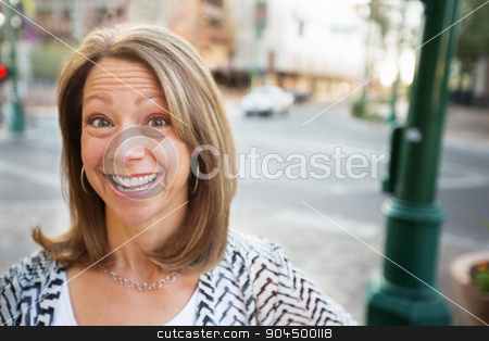 Woman with Glad Expression stock photo, Cute mature woman with excited expression standing outdoors by Scott Griessel