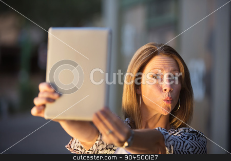 Lady Posing For Tablet stock photo, Woman posing for picture for tablet computer self-portrait by Scott Griessel