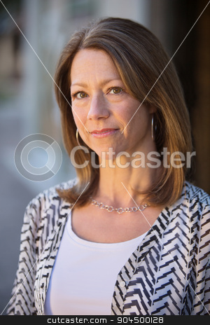 Serious Woman Standing stock photo, Serious beautiful single Caucasian woman standing outdoors by Scott Griessel
