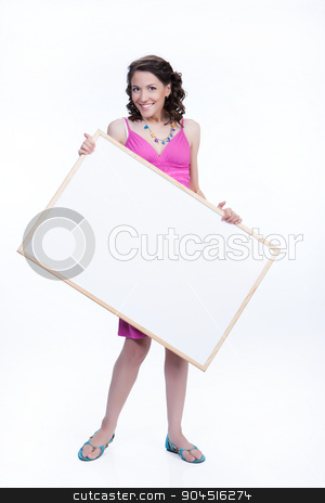 Young Smiling Woman With A Board stock photo, Young smiling woman holding a white board on isolated studio background by Andrey Skat