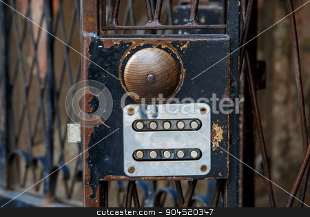 Wooden Doorknob of Iron Door stock photo, Close up detailed view of wooden brown round doorknob, on black rusty iron door. by mrbrainous