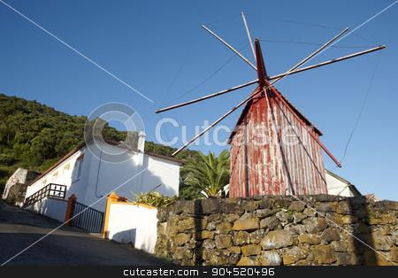 Red rusty windmill in Azores. Sao Jorge island. Portugal stock photo, Red rusty windmill in Azores. Sao Jorge island. Portugal. Horizontal by ABBPhoto