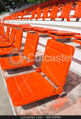 Empty red stadium seats at hockey field. stock photo, Empty red stadium seats at hockey field. by Sirikorn Techatraibhop