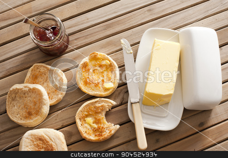 English Muffins, Butter and Jam on Wooden Table stock photo, High Angle View of Toasted English Muffins with Butter and Jam on Top of Wooden Table by Stephen Gibson