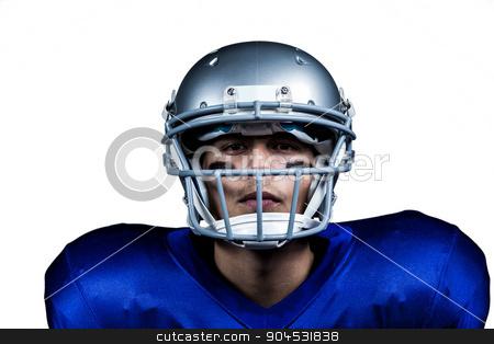 Portrait of determined American football player in uniform stock photo, Portrait of determined American football player in uniform against white background by Wavebreak Media