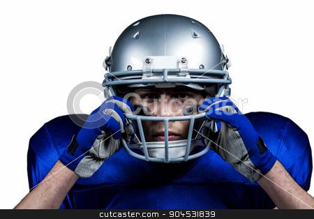 Portrait of American football player wearing helmet stock photo, Portrait of American football player wearing helmet against white background by Wavebreak Media
