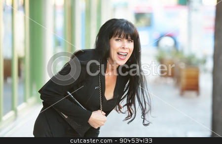 Woman Laughing Outdoors stock photo, Beautiful woman on a downtown street laughing by Scott Griessel