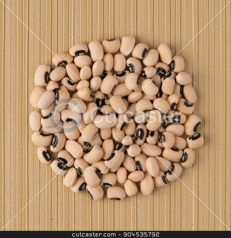 Circle of white beans stock photo, Top view of circle of white beans against yellow vinyl background. by Homydesign