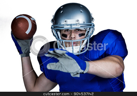 Portrait  of American football player with ball playing stock photo, Portrait  of American football player with ball playing against white background by Wavebreak Media