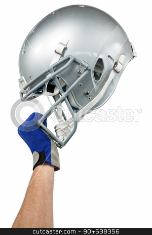 Cropped image of American football player handing his helmet stock photo, Cropped image of American football player handing his helmet on a white background by Wavebreak Media