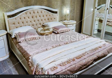 Elegant bedroom interior with  large bed stock photo, Elegant bedroom interior with a large bed by olgavolodina