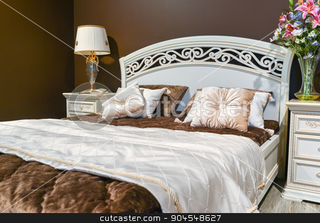 Elegant bedroom interior with  large bed stock photo, Elegant bedroom interior with a large bed by olgavolodina