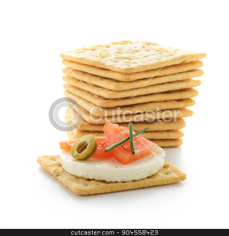 Crackers with cheese and tomato stock photo, Crackers with cheese and tomato isolated on white background by Homydesign