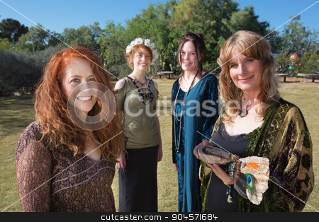 Four Modern Witches stock photo, Modern witches standing outdoors with ritual objects by Scott Griessel