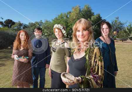 Polytheists Outdoors with Smudge Sticks stock photo, Group of Caucasian polytheists with smudge sticks standing outdoors by Scott Griessel
