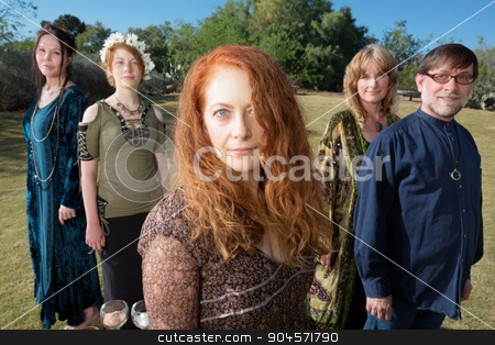 Beautiful Group of Adults stock photo, Women and man standing outdoors in pagan ritual clothing by Scott Griessel