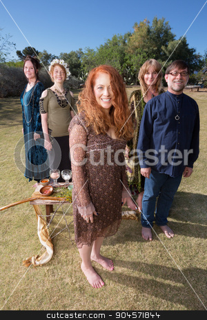 Barefoot Pagans Outdoors stock photo, Group of barefoot pagans in ritual standing outdoors with objects by Scott Griessel