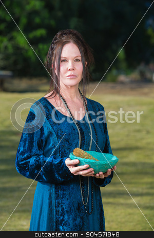 Priestess with Sage Incense stock photo, Serious Wicca priestess with blue bowl sage incense by Scott Griessel
