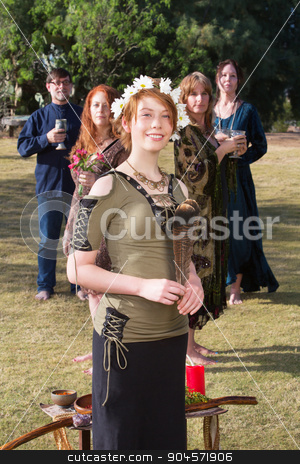 Cute Witch with Altar Outdoors stock photo, Cute Caucasian young witch holding feather near altar outdoors by Scott Griessel