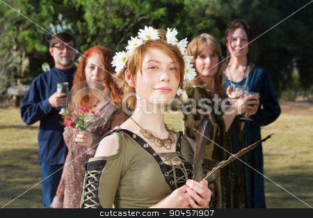 Confident Modern Witch stock photo, Young modern witch standing outdoors with feather and group by Scott Griessel