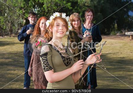 Woman Holding a Stick Pentagram stock photo, Young pagan woman with group holding a stick pentagram by Scott Griessel