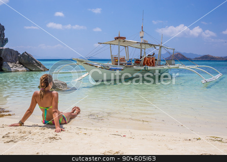 Young woman reaxing on the beach at exotic resort stock photo, Young Latino woman reaxing on the beach at exotic resort by Vassiliy Kochetkov
