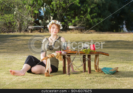 Lady in Wreath at Pagan Altar stock photo, Adult female sitting at pagan altar with wreath by Scott Griessel