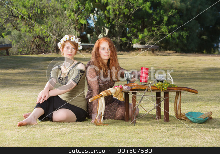 Two Serious Pagans at Altar stock photo, Two serious pagan females sitting at altar with pentagram by Scott Griessel