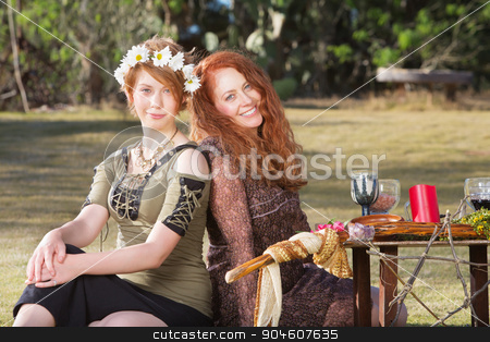 Pair of Smiling Pagan Women stock photo, Pair of smiling women at outdoor pagan altar by Scott Griessel