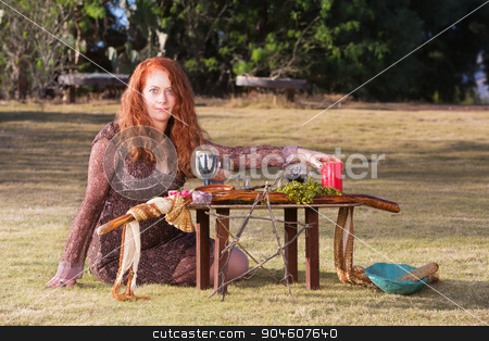 Beautiful Pagan Priestess stock photo, Caucasian priestess in outdoor pagan ritual with altar by Scott Griessel