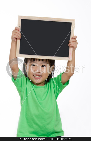 Asian Chinese little girl holding chalkboard  stock photo, Asian Chinese children holding balckboard in plain isolated white background. by Tan Kian Khoon