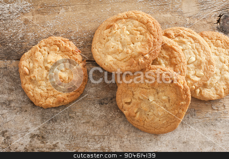 Fresh Baked Cookies on Rustic Wooden Table stock photo, High Angle View of Fresh Baked Cookies Scattered on Rustic Wooden Background by Stephen Gibson