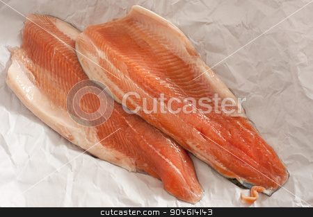 Two fresh raw trout fillets stock photo, Two fresh raw trout fillets laid out on crumpled white paper ready to be cooked for a gourmet seafood meal by Stephen Gibson