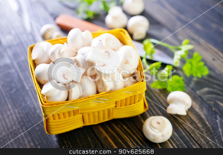 mushroom  stock photo, raw mushroom in basket and on a table by tycoon