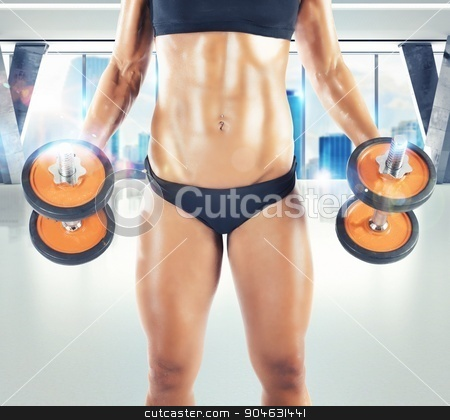 Workout in the gym stock photo, Muscular woman is training in a gym by Federico Caputo
