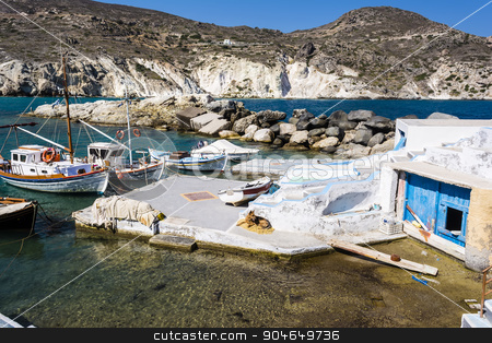 Mandrakia traditional Greek village stock photo, Mandrakia traditional Greek village with sirmate  - fish boats and a dog at Milos island, Greece. by ANTONIOS KARVELAS