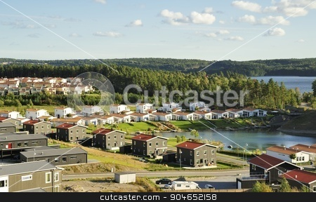 Erkerö stock photo, Homes with Pond. Scene of prime real estate community. Living in serenity. by a40757