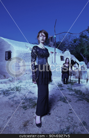 Beautiful Young Witch stock photo, Beautiful young witch in black next to Wicca altar by Scott Griessel
