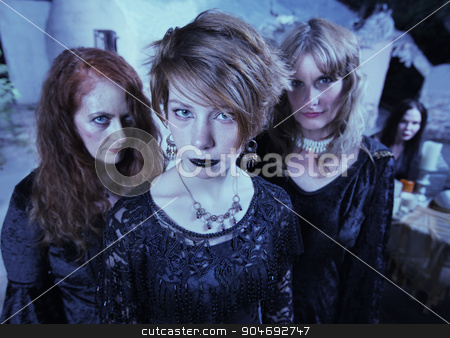Serious Pagan Women in Black stock photo, Trio of female adults in Wicca ceremony outdoors by Scott Griessel