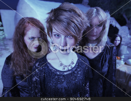 Witches Standing Outdoors stock photo, Three beautiful women in black standing together outdoors by Scott Griessel