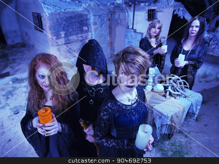 Coven of Five Witches stock photo, Coven of five witches outdoors holding candles by Scott Griessel