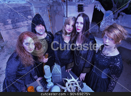 Coven of Witches at Altar stock photo, Coven of witches next to altar with antlers by Scott Griessel