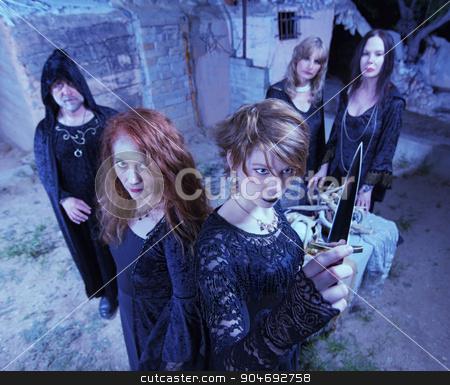 Occult Sacrifice Ritual stock photo, Five witches with dagger in occult sacrifice ritual by Scott Griessel