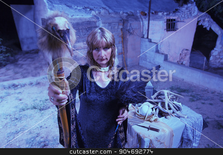 Blond Witch with Bird Staff stock photo, Single witch outdoors with crow wings and bird head by Scott Griessel